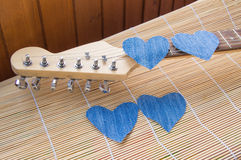 Heart of denim on the guitar. Happy friendship day Royalty Free Stock Photos
