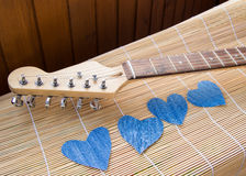 Heart of denim on the guitar. Happy friendship day.  royalty free stock images