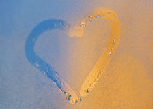 Heart from dew drops on the window Stock Image