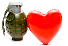 Heart Disease. The concept of cardiovascular disease with a heart and grenade Royalty Free Stock Images
