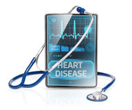 Heart disease. Modern tablet displaying warning of cardiovascular disease Royalty Free Stock Images