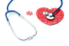 Heart disease, puzzle heart with stethoscope Stock Image
