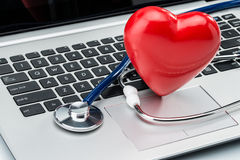 Heart disease research, stethoscope and heart shape on laptop ke Royalty Free Stock Images