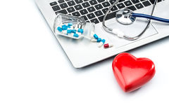 Heart disease research, stethoscope and heart shape on laptop ke Royalty Free Stock Photo