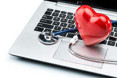 Heart disease research, stethoscope and heart shape on laptop ke Stock Photography