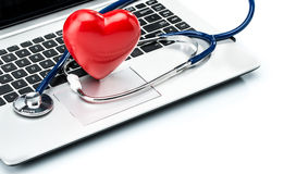 Heart disease research, stethoscope and heart shape on laptop ke Royalty Free Stock Photography