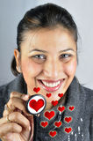 Heart doctor. Smiling doctor with stethoscope in her hand stock photography