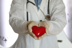 Heart in doctor hand Royalty Free Stock Images