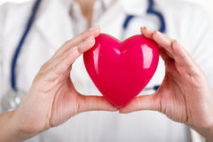 Heart in doctor's hands Stock Photo