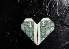 Heart dollar Stock Photos