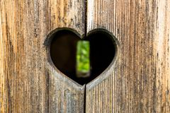 Heart in the Door of a Wooden Toilet royalty free stock image