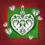 Heart with doves of white paper on red background Stock Photos