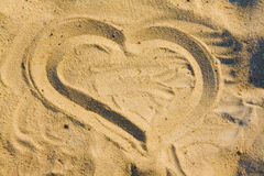Heart draw on sand royalty free stock photo