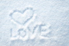 Heart draw on smow with the word LOVE. The message by St. Valentine's Day, declaration of love Stock Photography