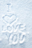 Heart draw on smow with the words I LOVE YOU. The message by St. Valentine's Day, declaration of love Royalty Free Stock Photography