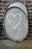 Heart drawen with chalk. Heart drawn with chalk on zinced bath tub royalty free stock images
