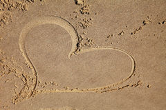 Heart drawing on the beach. Heart drawing on the sandy beach stock photos