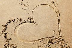 Heart drawing on the beach. Heart drawing on the sandy beach stock photos