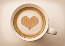 Heart drawing on coffe. Love cup , heart drawing on latte art coffee stock photos