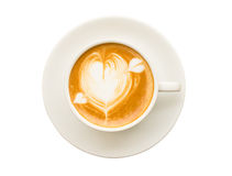Heart drawing on cup of coffee isolated on white background. Top view heart drawing on cup of coffee isolated on white background Stock Images