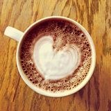 Heart drawing on hot chocolate cup stock photos