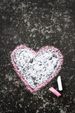 Heart drawing. Heart drawn in chalk on concrete stock image