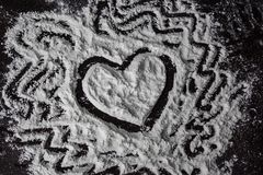 Heart drawing on the flour stock photo