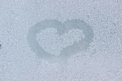 A heart drawing on a frozen window. As a background royalty free stock photos