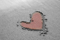 Heart drawing on the sand beach. Pink heart drawing on the sand beach royalty free stock image