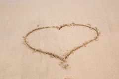 Heart drawing in the sand on a beach Stock Image