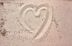 Heart drawing in the sand. Heart hand drawing in the sand at the beach stock photo