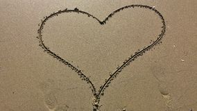 Heart drawing in sand Royalty Free Stock Image