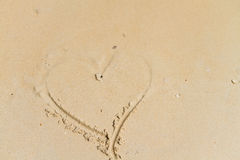 Heart drawing on sand. Heart shape drawing on sand royalty free stock photo