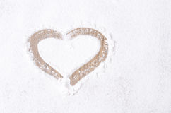 Heart drawn on the background of powdered sugar, horizontal Stock Image