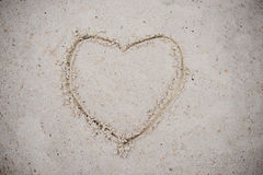 Heart, drawn on the beach sand. heart symbol on the sand washed Royalty Free Stock Photos