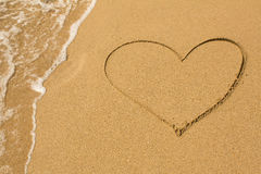 Heart drawn on the beach sand Stock Image