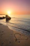 Heart drawn on the beach sand royalty free stock photos