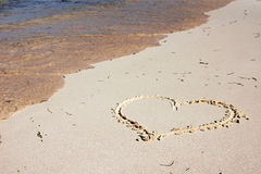 Heart drawn on the beach Royalty Free Stock Photos
