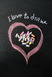Heart drawn on the blackboard with chalk. Stock Photo