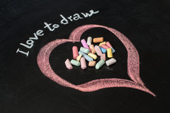 Heart drawn on the blackboard with chalk. Stock Images