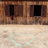 Heart drawn by chalk on the ground near wooden. Heart drawn by chalk on the ground near wooden temple stock image