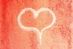 Heart drawn in chalk on a red concrete wall.  royalty free stock photo