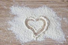 Heart drawn on flour Royalty Free Stock Photo