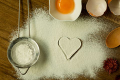 Heart drawn in flour and ingredients for cooking Stock Photography