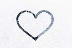 Heart drawn on frosty window. Royalty Free Stock Image