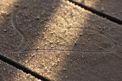 Heart drawn on frozen plank in morning sun royalty free stock images