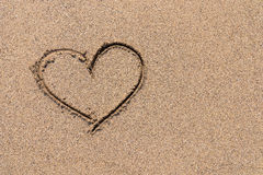 Heart Drawn On Ocean Sand Royalty Free Stock Images