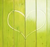 Heart drawn over the green boards Royalty Free Stock Images