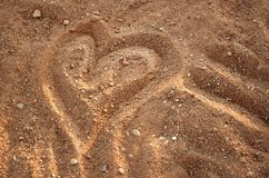 Heart drawn / painted on the sand on the beach. Symbol of love stock photos