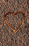 Heart drawn on pebbles Stock Image